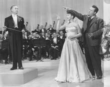 Publicity Photo with Jose Iturbi, MGM Symphony Orchestra and director George Sidney