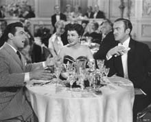 Scene with Mario Lanza and David Niven with Bess Flowers in the background